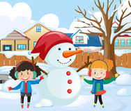 Two girls making snowman in the park Royalty Free Stock Photography