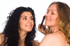 Two girls making up Royalty Free Stock Photo