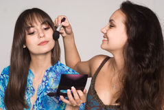 Two girls making up Stock Photography