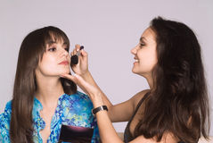 Two girls making up royalty free stock photography