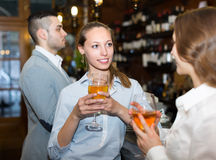 Two girls with man at bar Stock Photography