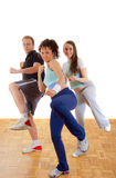 Two girls and man exercising together, kicking Royalty Free Stock Photo