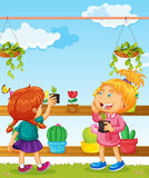 Two girls and many flower pots Royalty Free Stock Images