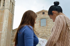 Two girls with map Stock Photos