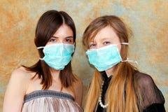 Two girls mask Royalty Free Stock Image