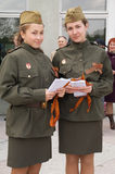 Two girls in the military dress Royalty Free Stock Photography