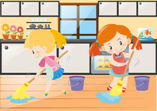 Two girls mopping the kitchen floor Stock Image
