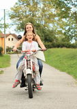 Two girls on a motorbike Stock Photo