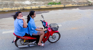 Two girls on a motorcycle in Thailand Stock Photos