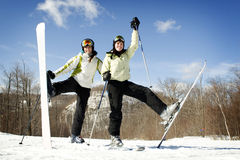 Two Girls on mountain top ready for skiing Stock Images