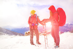 Two girls in the mountains in winter. Stock Photos