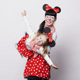Two girls with mouse masks Royalty Free Stock Images