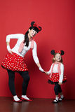 Two girls with mouse masks Royalty Free Stock Photography