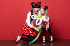 Two girls with mouse masks Stock Photo