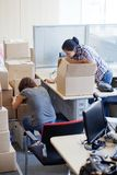 Two girls move into a new office. Royalty Free Stock Photo