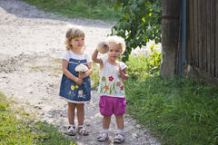 Two girls with a mushroom an umbrella stock image