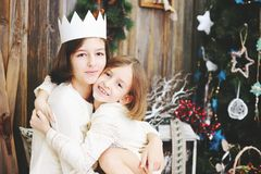Two girls near Christmas tree Stock Photo