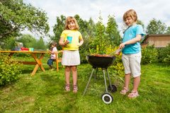 Two girls near grill making BBQ in the garden Stock Image
