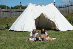 Two girls near tent in camp of Vikings Royalty Free Stock Image