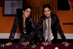 Two girls next to a snooker table Stock Photo