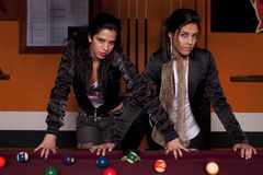 Two girls next to a snooker table Stock Images