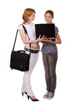 Two girls with notebook Royalty Free Stock Image