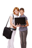 Two girls with notebook Stock Photography