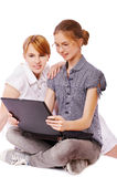 Two girls with notebook Stock Photo