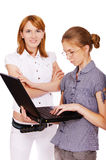 Two girls with notebook Stock Image