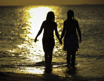 Two Girls and a Ocean Stock Images