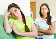 Two girls offended on each other Stock Photo