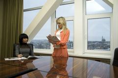 Two girls in the office, boss and secretary Royalty Free Stock Images