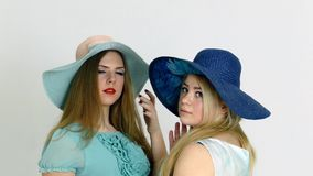 Two girls in old style hat posing. Two girlfriends in old style hat posing stock video