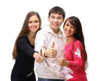 Two girls and one guy. Show the thumbs up. Isolated on white background Royalty Free Stock Photography