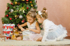 Two girls opening Christmas gift Royalty Free Stock Images