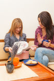 Two Girls Opening Present Stock Image