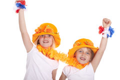 Two girls in orange cheer. Two holland supporters in orange cheer against white background stock images
