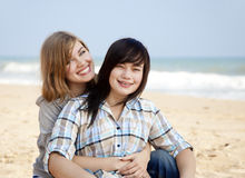 Two girls at outdoor near sea Stock Photos