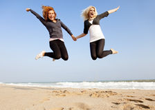 Two girls at outdoor near sea. Stock Photo
