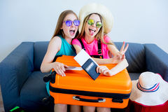 Two girls packing suitcases Royalty Free Stock Image