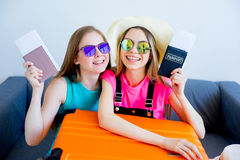 Two girls packing suitcases Royalty Free Stock Photos