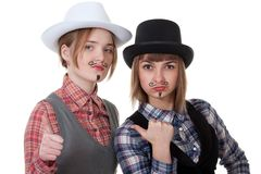 Two girls with painted mustaches Royalty Free Stock Photography