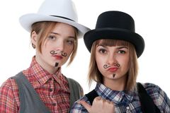 Two girls with painted mustaches Royalty Free Stock Photo