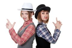 Two girls with painted mustaches Royalty Free Stock Images