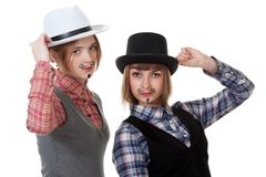 Two girls with painted mustaches Stock Photo