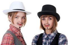 Two girls with painted mustaches Stock Photos
