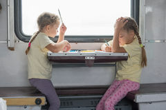 Two girls painted for the side table in the second-class train carriage Stock Photography