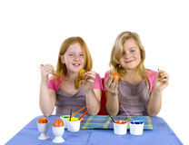 Two girls painting easter eggs Stock Photography