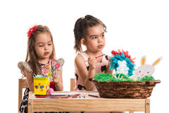 Two girls painting Easter eggs Royalty Free Stock Images