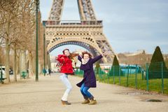Two girls in Paris near the Eiffel tower Royalty Free Stock Image